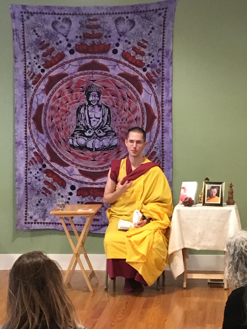 Picture of Kelsang, a Buddhist Monk in front of a class of students.